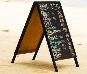 chalk blackboard menu on the beach