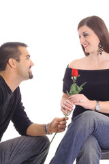man giving woman a rose
