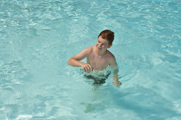 young boy in pool