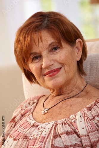 Portrait of attractive elderly woman at home
