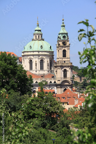 View on Prague's St. Nicholas' Cathedral with flowering trees