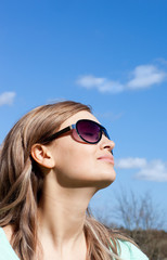 Relaxed blond woman with sunglasses outdoors