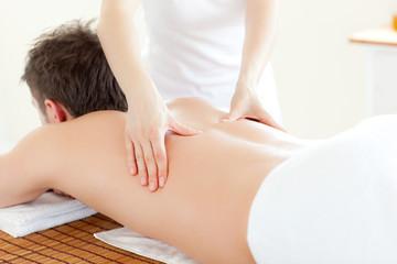 Caucsasian young  man receiving a back massage