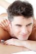 Handsome man enjoying a back massage