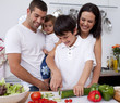 Happy young family cooking together