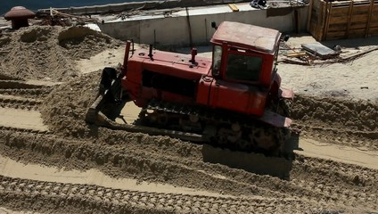 Red bulldozer at work in sea port (Full HD)
