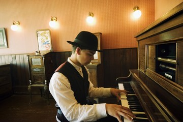 Man Playing Vintage Piano