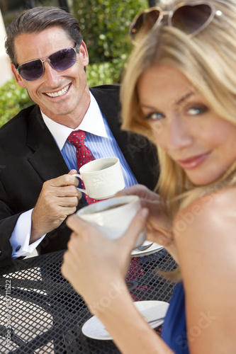Attractive Couple Drinking Coffee At Outdoor Cafe or Restaurant