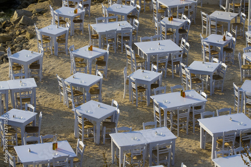 Tables are Set for Evening Dinner. Mykonos Island, Greece