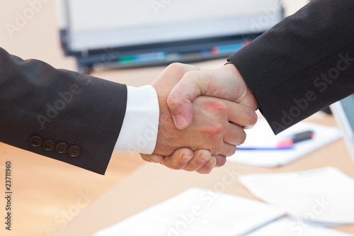 boss is shaking hands