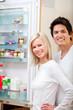 Couple looking inside the fridge