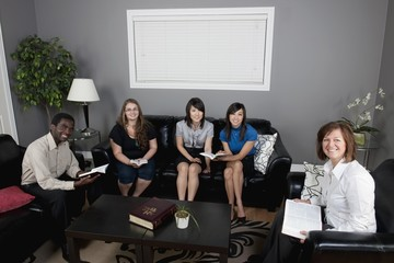 A Group Of People Having A Bible Study