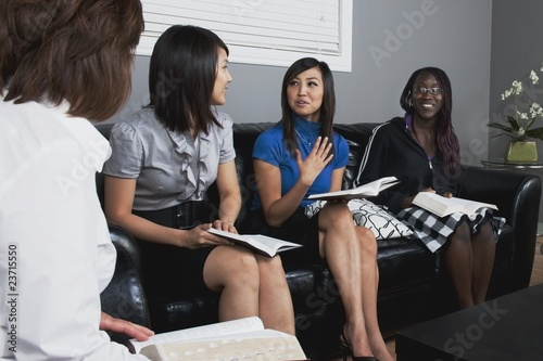 Woman Talking In A Bible Study