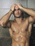 Fototapety good looking man under man shower