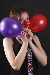 Mime with red nose and baloons