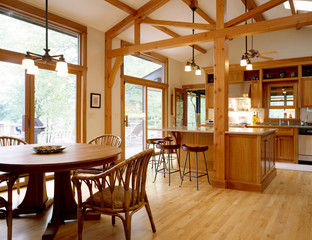 Dining Area and Kitchen with Exposed Wood Trim
