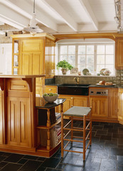 Stone Tile Floor and Wooden Cabinetry in Kitchen