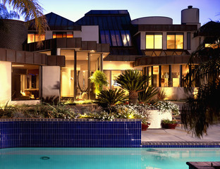 Pool and Patio Behind Contemporary House