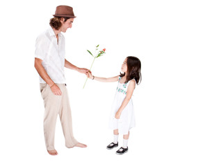 Girl gives dad a flower