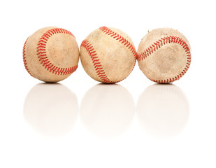 Three Baseballs Isolated on Reflective White
