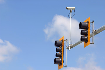 Secure camera with traffic light and sign.