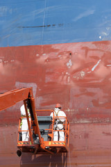 worker repair ship hull