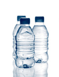 purified spring mineral water in the bottles with reflection poster
