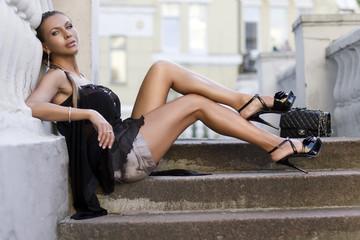 woman sitting on ladder steps