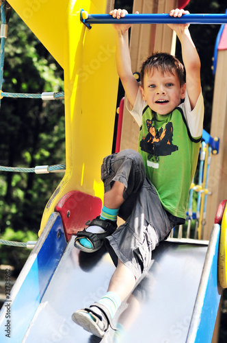 funny boy on the slide