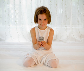 Child with mobile phone - cellphone with SMS