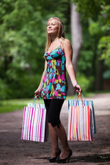 Young woman with shopping bags.