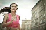 Young person listening misic running in city street - 23751387