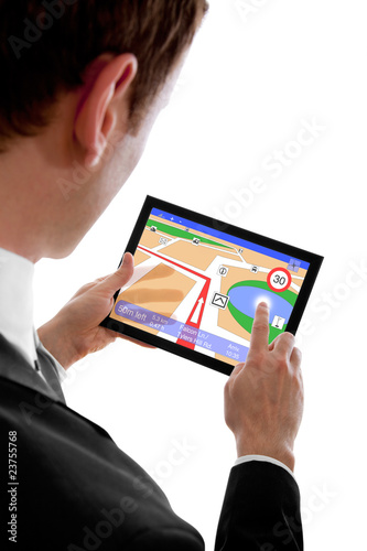 businessman holding a touchpad pc, using the navigation programm