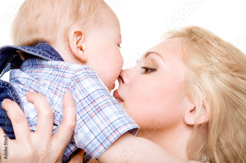 Mom kissing baby