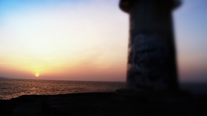 Old lighthouse towards sunset. HD 1080p, Selective focus.