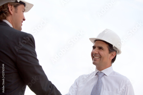 Handshake at a construction site
