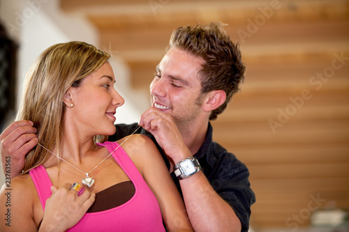 Man buying a necklace for his girlfriend