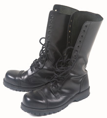 steel toe black leather boots on white background