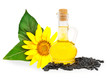 Small bottle with sunflower-seed oil and sunflower seeds