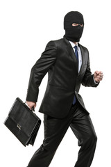 A man in robbery mask carrying a briefcase isolated on white