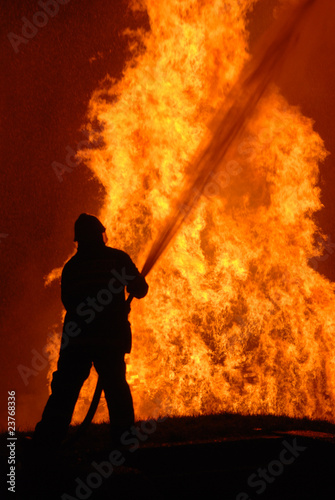 lone fireman battling against raging fire