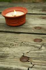 carved names with candle