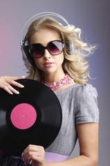 Blond woman listening music