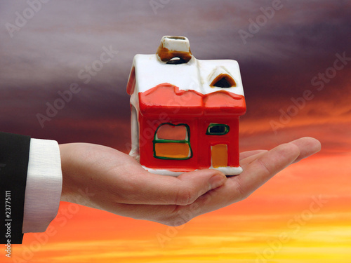 The Hand of the Businessman with the House