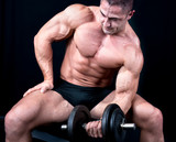 Man on bench with a bar weights in hands training