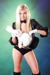 Cute magician and bunny popping out her top hat