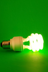 CFL Bulb on green background