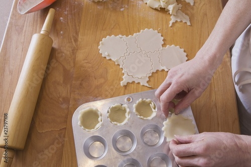 Person Placing Dough Into Muffin Pan