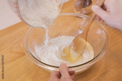 Person Mixing Ingredients Into A Bowl