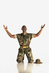 A Military Man With Arms In The Air And Looking Upwards